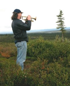 Michael playing his trumpet off the Denali Highway